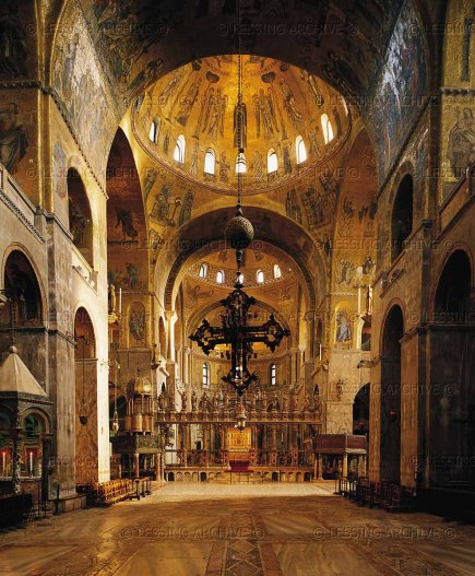 Interior of St. Mark's Basilica, Venice. View through the central nave towards transept and apse. Mosaics, begun in the 11th century, cover more than 4000 sq.m. Iconostasis with 14 statues of Saint Mary and the apostles.
