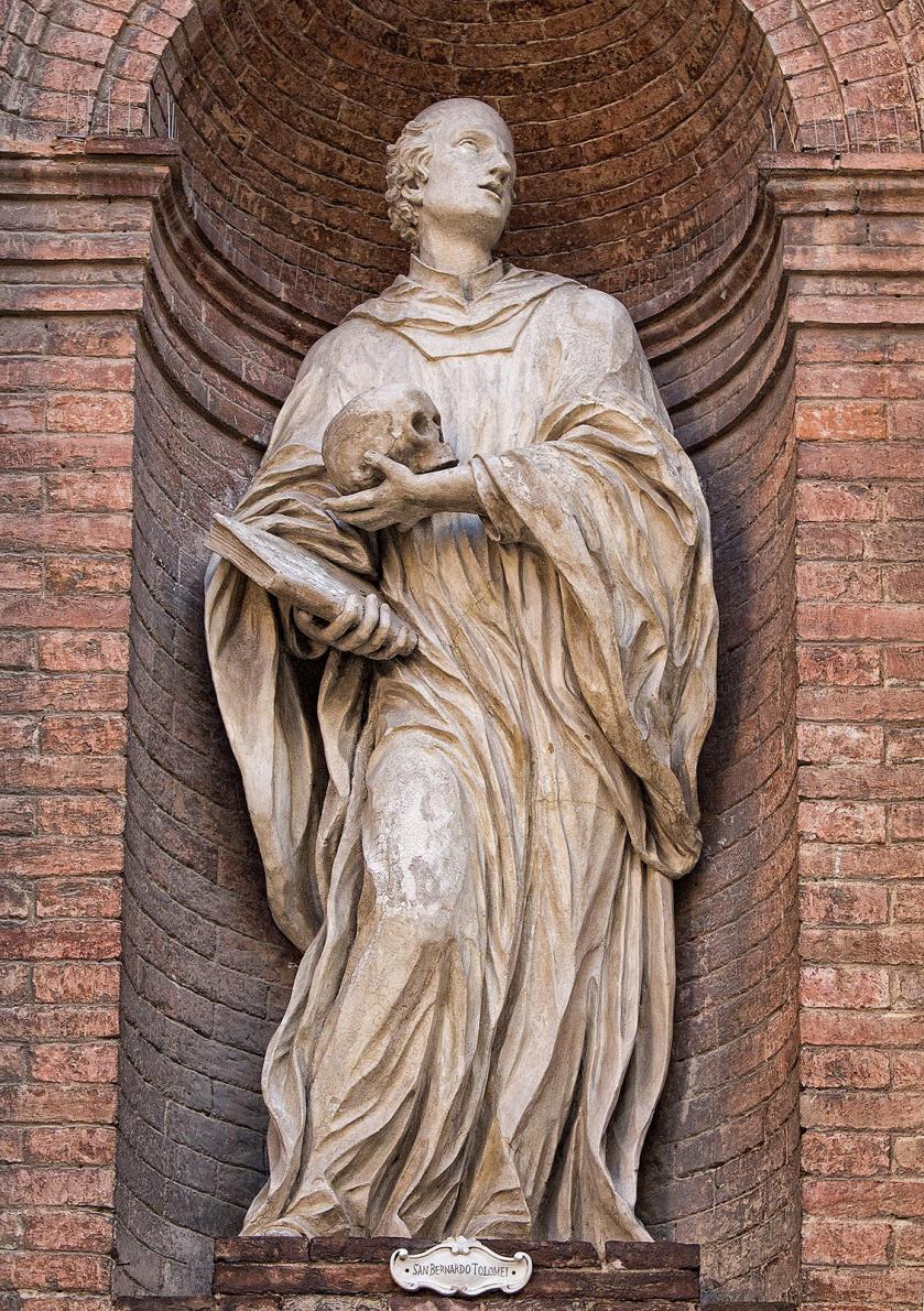 A statue of San Bernardo Tolomei on the Chiesa di San Cristoforo in the Piazza Tolomei, Siena Italy.