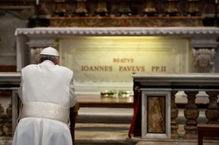 Pope Francis prays in front of the tomb of the late Blessed John Paul II in St. Peter's Basilica at the Vatican April 2, the eighth anniversary of his death. (CNS photo/L'Osservatore Romano via Reuters) (April 2, 2013)