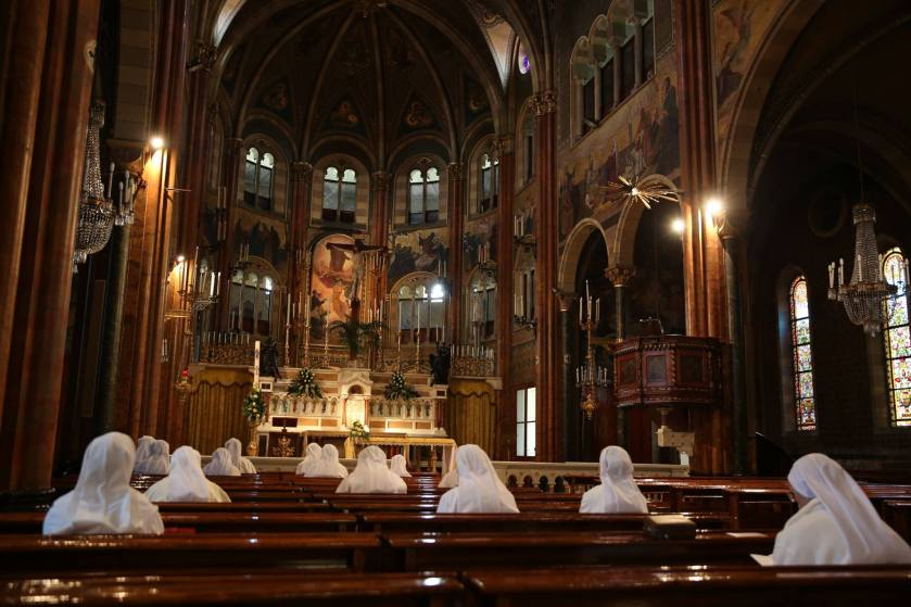 The Sisters of St. Joseph Cottolengo pray before the blessed sacrament inside the Chiesa Piccola.jpg