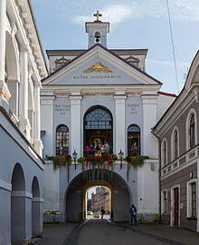 The Gate of Dawn in Vilnius; the painting can be seen through the glass window