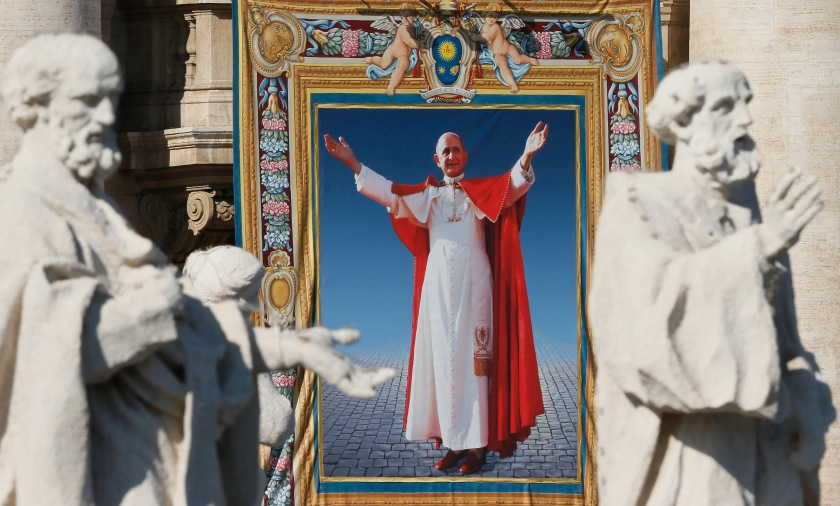Tapestry of Blessed Paul VI hangs from facade of St. Peter's Basilica during his beatification Mass at Vatican