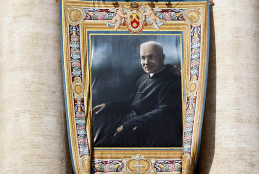 A tapestry showing new Canadian Saint Andre Bessette hangs from Saint Peter's Basilica as Pope Benedict XVI leads a solemn mass in Saint Peter's square